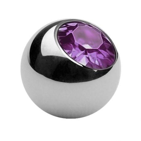 Stalowa kulka z kolorowym kryształkiem